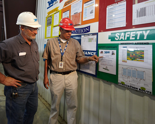 VAM USA employees review a safety board at the beginning of their shift